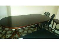 Used solid dark wood table