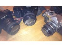 Film cameras, manuals, Minolta, Yashica.