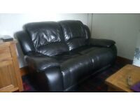 2 x Two seater black leather recliner settee