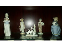 Selection of NAO and LLADRO collectible figurines
