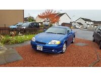 Blue Hyundai Coupe 1.6 S 54 plate