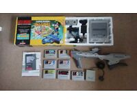 SUPER NINTENDO BOXED WITH 7 GAMES AND SCOPE £150