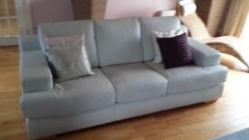 Pale blue leather sofa and chair