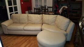 Soft leather cream corner settee with matching pouffe. In good clean condition.