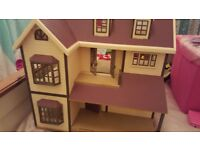 Mixture of sylvanian families including bakery, wedding Chaple, House, Car, Boat many families