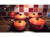 Set of four Le Creuset solid iron