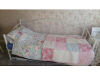 Beautiful white metal framed day bed / guest bed