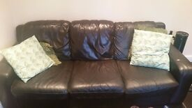 Dark brown/black leather three seater sofa and armchair