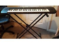 Casio CTK-240 electric keyboard with adjustable stand