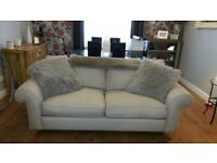 Barely used 3 seater sofa and matching footstool with storage in light beige