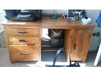 solid wood desk used but good condition. has 3 drawers on side and other side has 1 large drawer