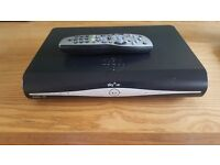 SKY HD box with remote control and power cable.