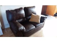 Very comfortable 2 seater brown leather sofa in excellent condition.