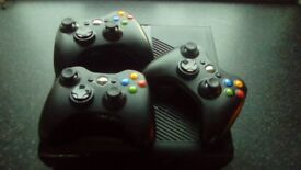 Xbox 360 with 3 wireless controllers and 4 games.