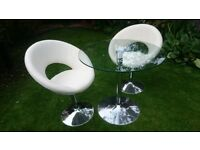 Stylish Dwell round glass dining table and 2 retro swivel dining chairs