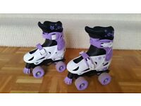 Childrens adjustable roller skates size 11-13 in purple and white