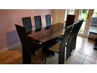 Extending glass dining table and 8 chairs.