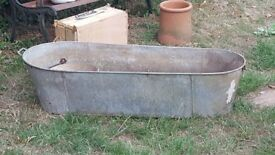 Old coffin shape tin bath. Great garden feature