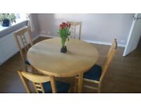 Dining Table + 6 chairs - extending from round to oval (from 117cm to max 210cm) beech veneer