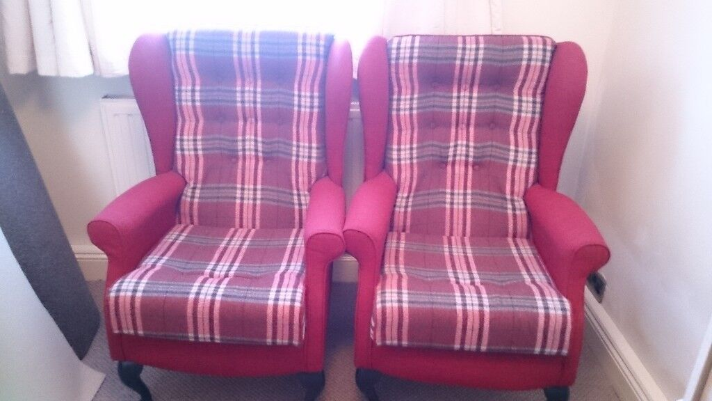 Two reupholstered wing back chairs