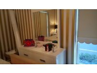White High Gloss Wardrobe,Dresser and two Bedside Lockers in good condition.