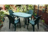 Four garden chairs and table.