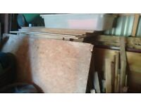 A large selection of timber joists, sheets, doors, gates, pallets, and oak