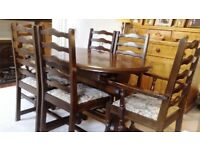 extending oak dining table and 6 chairs