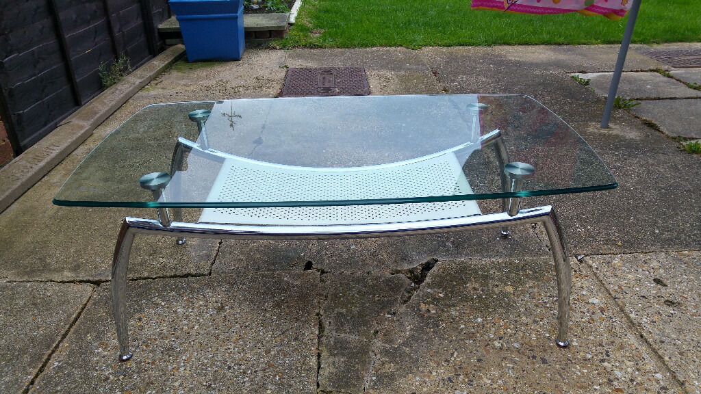 Glass coffee tablein Bletchley, BuckinghamshireGumtree - Good quality modern glass coffee table (L110cm W62cm H43cm),solid chrome legs. Glass itself is thick and heavy. Very good condition, a few years old so there are a few scratches but nothing major, can be dismantled and reassembled if needed. Bought...