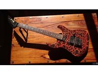 "Charvel Model 5fx thru-neck electric guitar in ""firecrackle"" with locking tremolo and hard case"