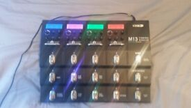 Line 6 M13 Guitar multi effect with power supply.