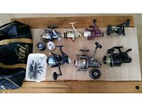 7 fishing reels, bait weights and bag