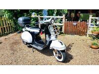Mint condition, retro style 125cc scooter black &white with Orange stripes