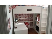 White high bed, with storage and desk system which is great for a kid's room. In good conditon..