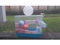 Hamster cage ,rrp £35,and an exercise ball,some cosmetic scratches but otherwise fine