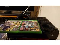 Xbox one with charger for 2 controler and a very long cable to charge while playing and 3 games