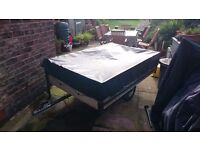 6ft by 4ft trailer with two covers and special brackets to it to be stowed on its side