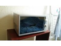 Silver Microwave In Good Condition (clear) plus local delivery