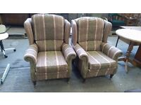 2 arm chairs on front castorse