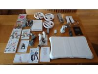 Nintendo Wii with controllers, Fit Board, Steering Wheels, Joysticks, Games & cables