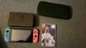 Nintendo Switch with Fifa 18 and travel bag