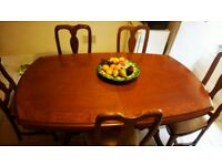 Beautiful real wood 6-8 table and chairs