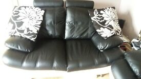 Faux black and white leather 2 seater and 3 seater sofa kept in immaculate condition