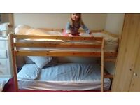 CHILDS CABIN BED, TWO MATTRESSES, LOTS OF BEDDING. GRAB A BARGAIN