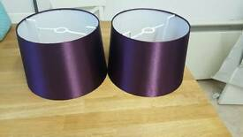 Two purple lampshades