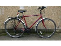 Mens Hybrid Bike in Red Apollo Radius with mudguards and rack