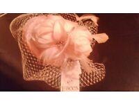 stunning delicate light pink facinator hat
