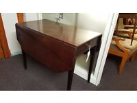 An early Victorian mahogany Pembroke table