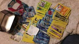 Pokemon cards and tin, near mint