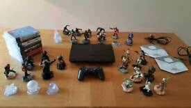 PlayStation 3 250gb with Disney Infinity figures and games